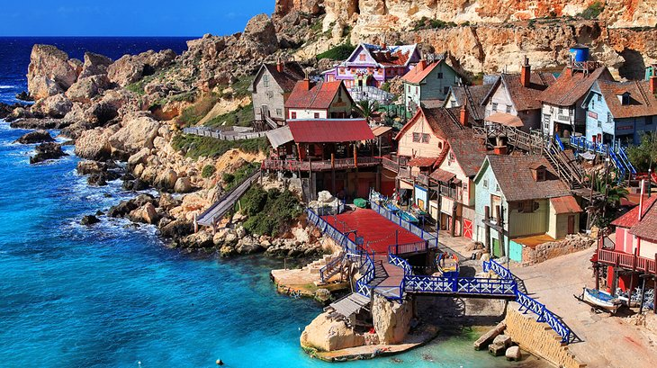 Film set from the 1980 musical 'Popeye', now a theme park village with boat rides & food outlets.